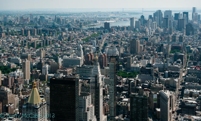 Brooklyn Bridge is furthest downriver in the smoggy background. From Empire State Building NYC June 2013